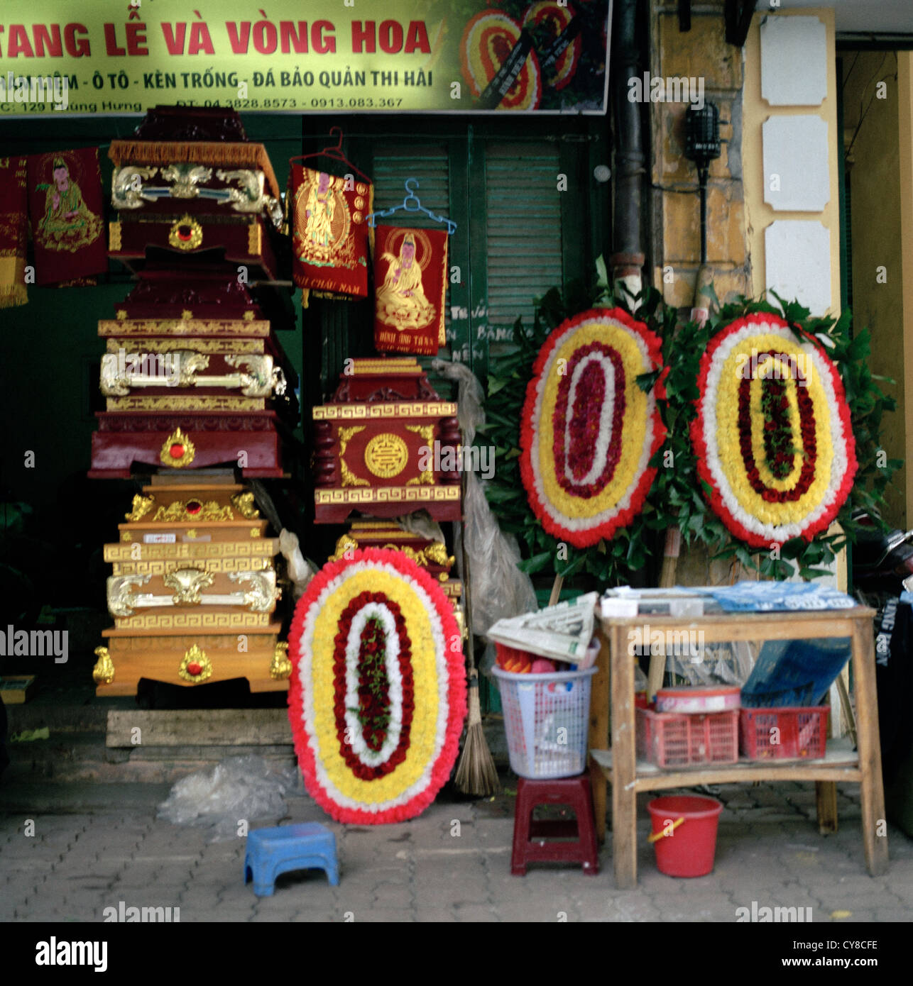 Funeral undertaker in the Old City of Hanoi in Vietnam in Far East Southeast Asia. Coffin Wreath Death Business Stock Photo