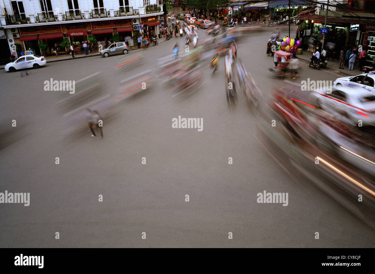 Traffic motion in the Old City of Hanoi in Vietnam in Far East Southeast Asia. Rush Speed Inspiration Commotion - Stock Image