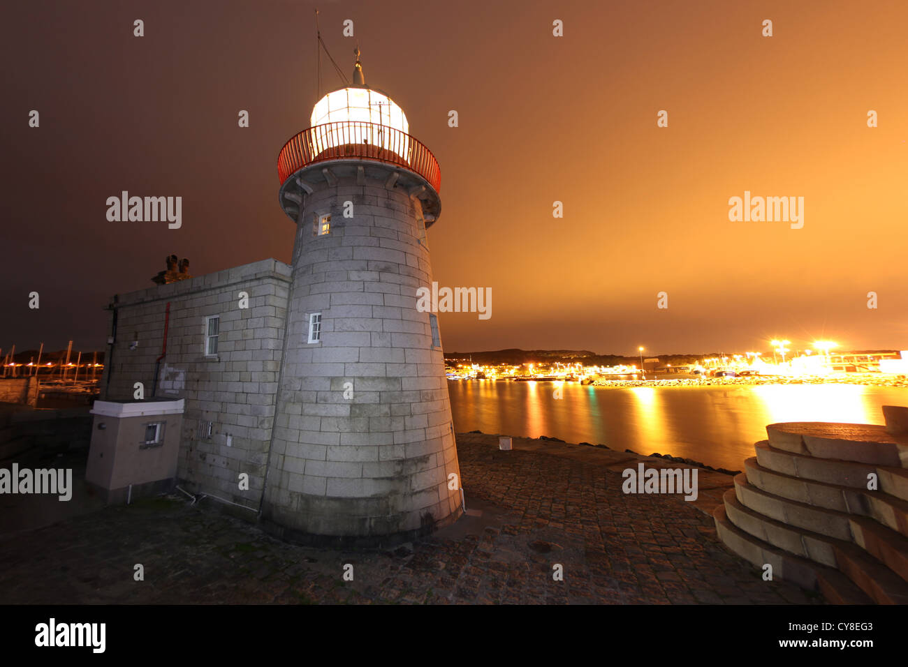 Howth Harbour lighthouse on the end of the southern arm of Dublin harbour. - Stock Image