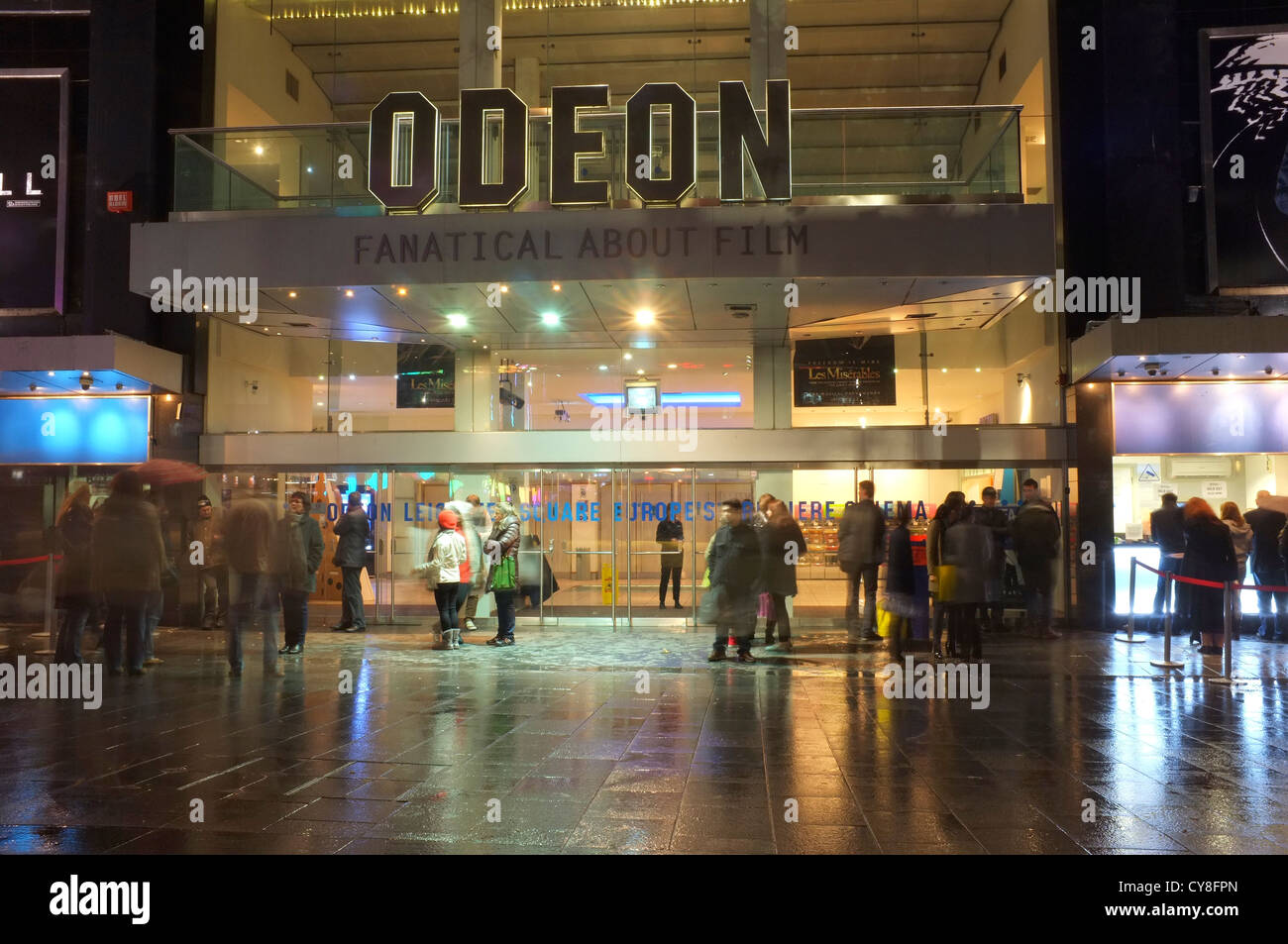 Odeon Cinema with people gathered outside in Leicester square, London - Stock Image