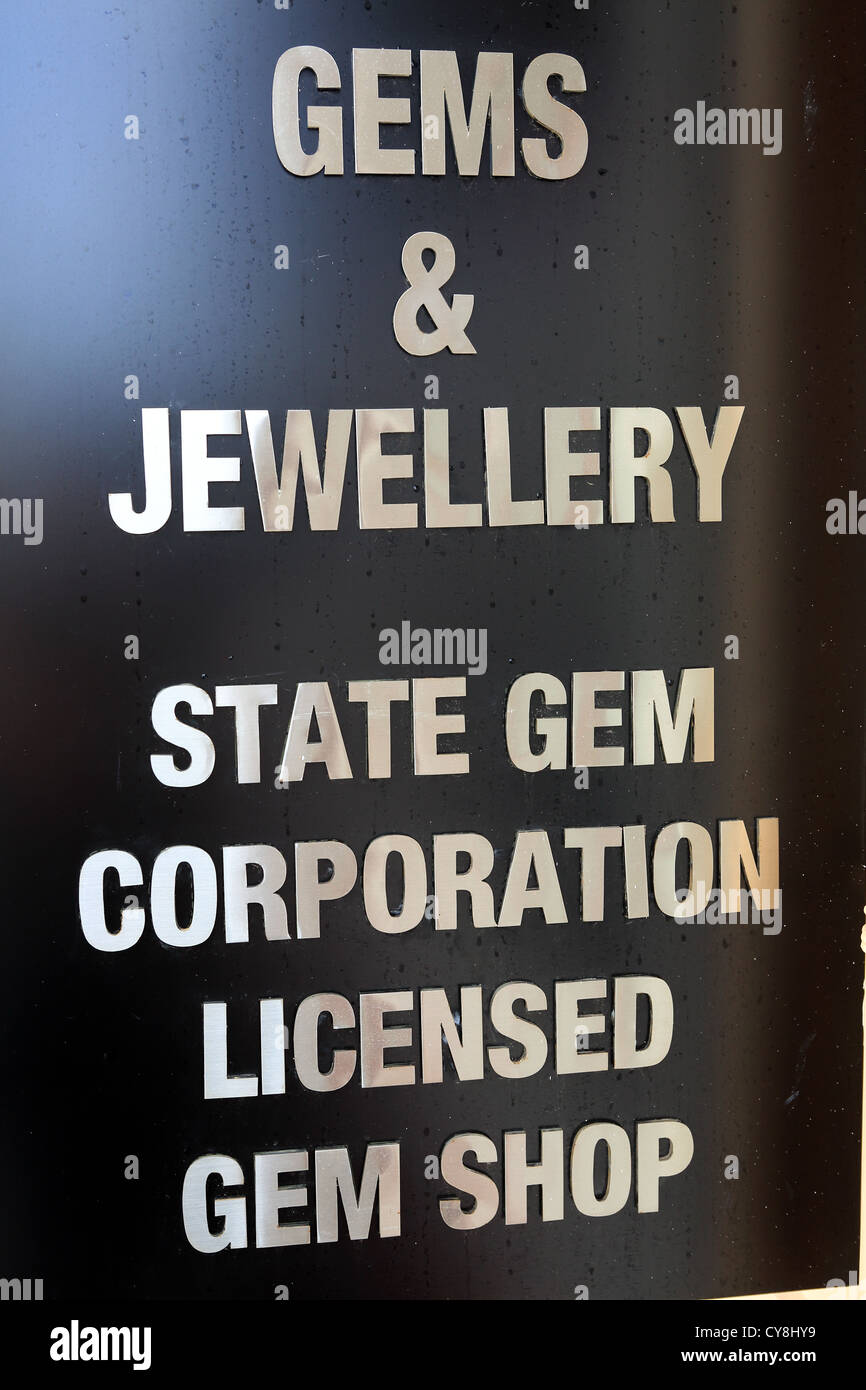 Jewelery and gemstone shop sign inside Galle Fort, licensed by the State Gem Corporation of Sri Lanka. - Stock Image
