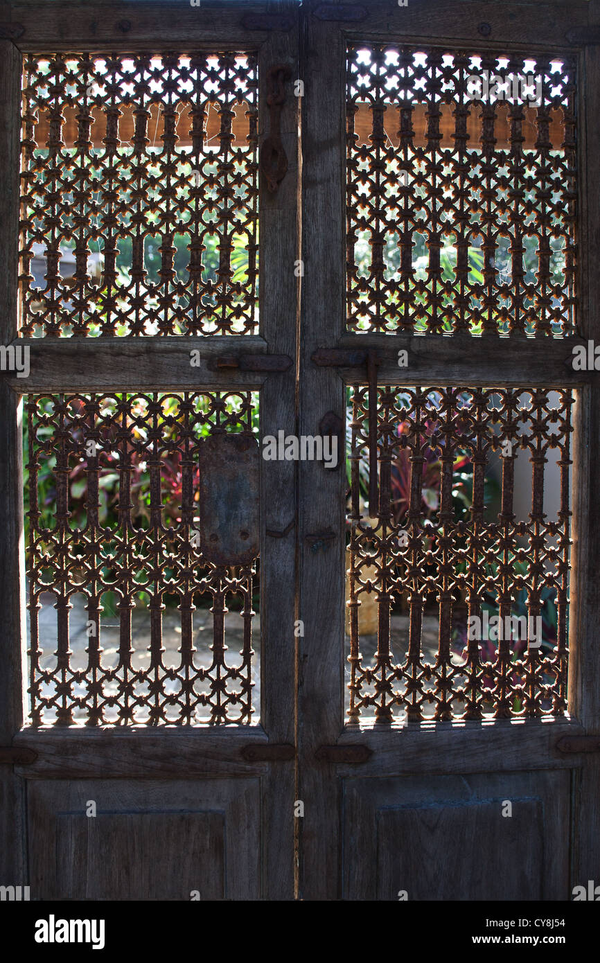 Balinese style large wooden carved doors in Bali Indonesia with metal door knocker and studs. & Balinese style large wooden carved doors in Bali Indonesia with ...
