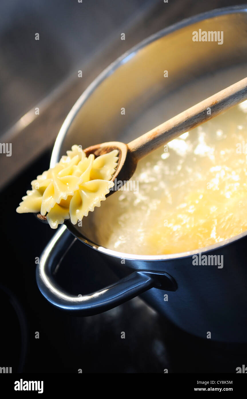 development of a recipe in a saucepan on the fire - Stock Image