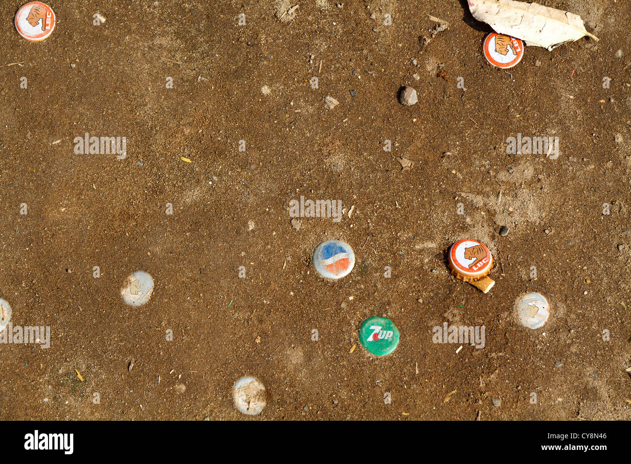 Colorful Crown Caps in the Sand in Vientiane, Laos - Stock Image