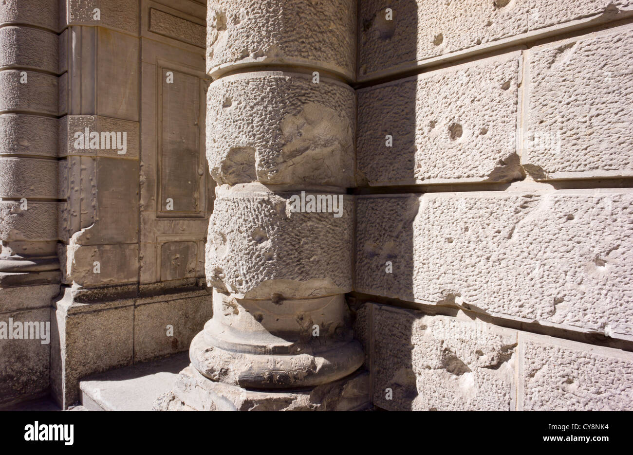 Bullet ridden wall on an old building in Berlin, Germany. - Stock Image