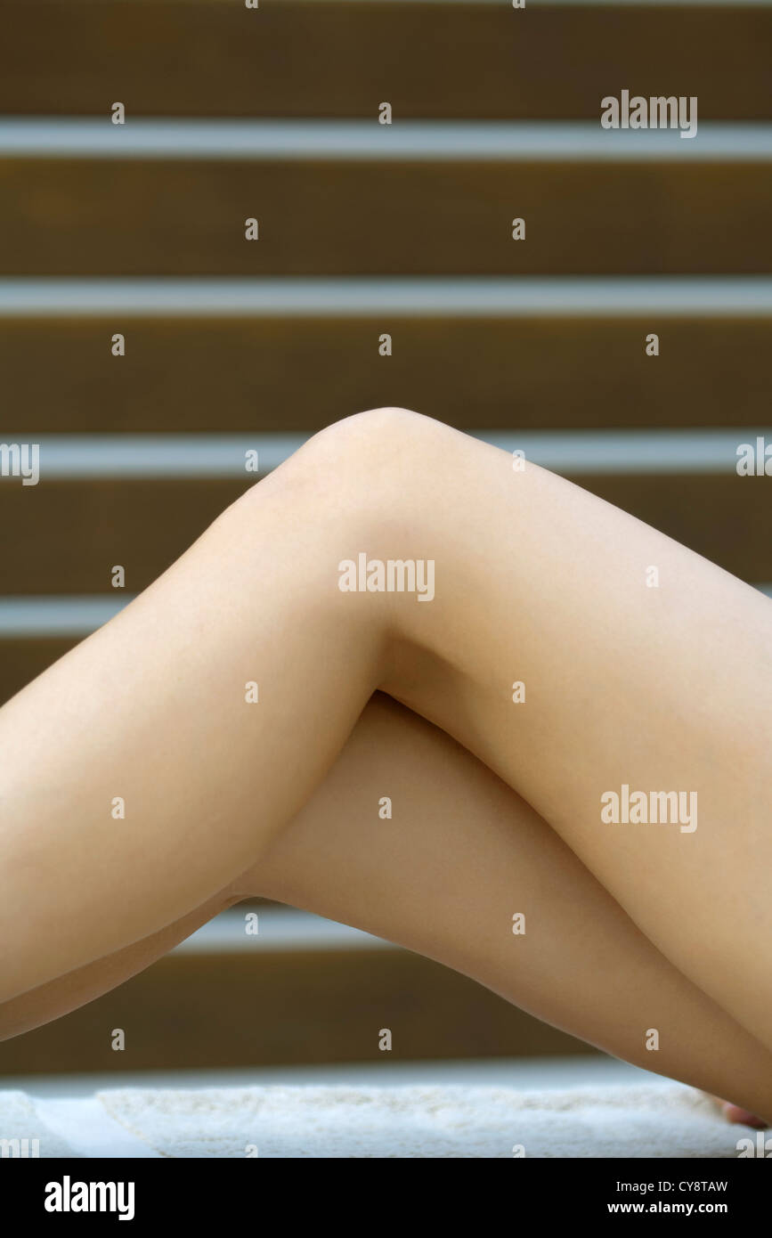 Woman's bare legs, cropped - Stock Image