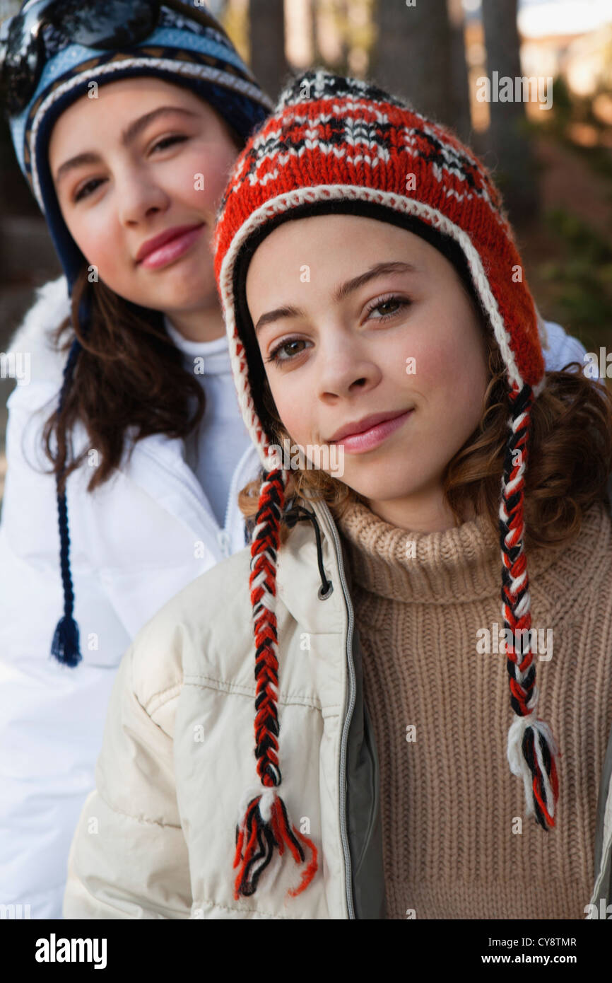 Preteen girl and friend wearing knit hats, portrait - Stock Image