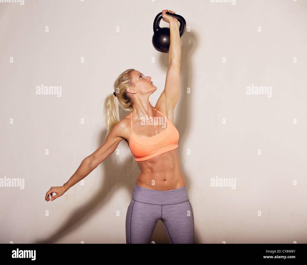 Woman doing her kettlebell crossfit workout - Stock Image