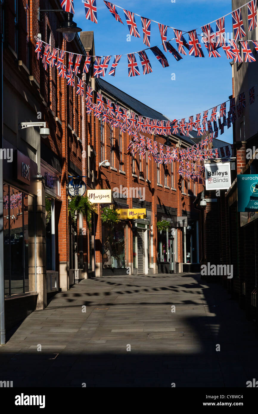 Shops In Durham City Center With Union Flags On Bunting Sunlit