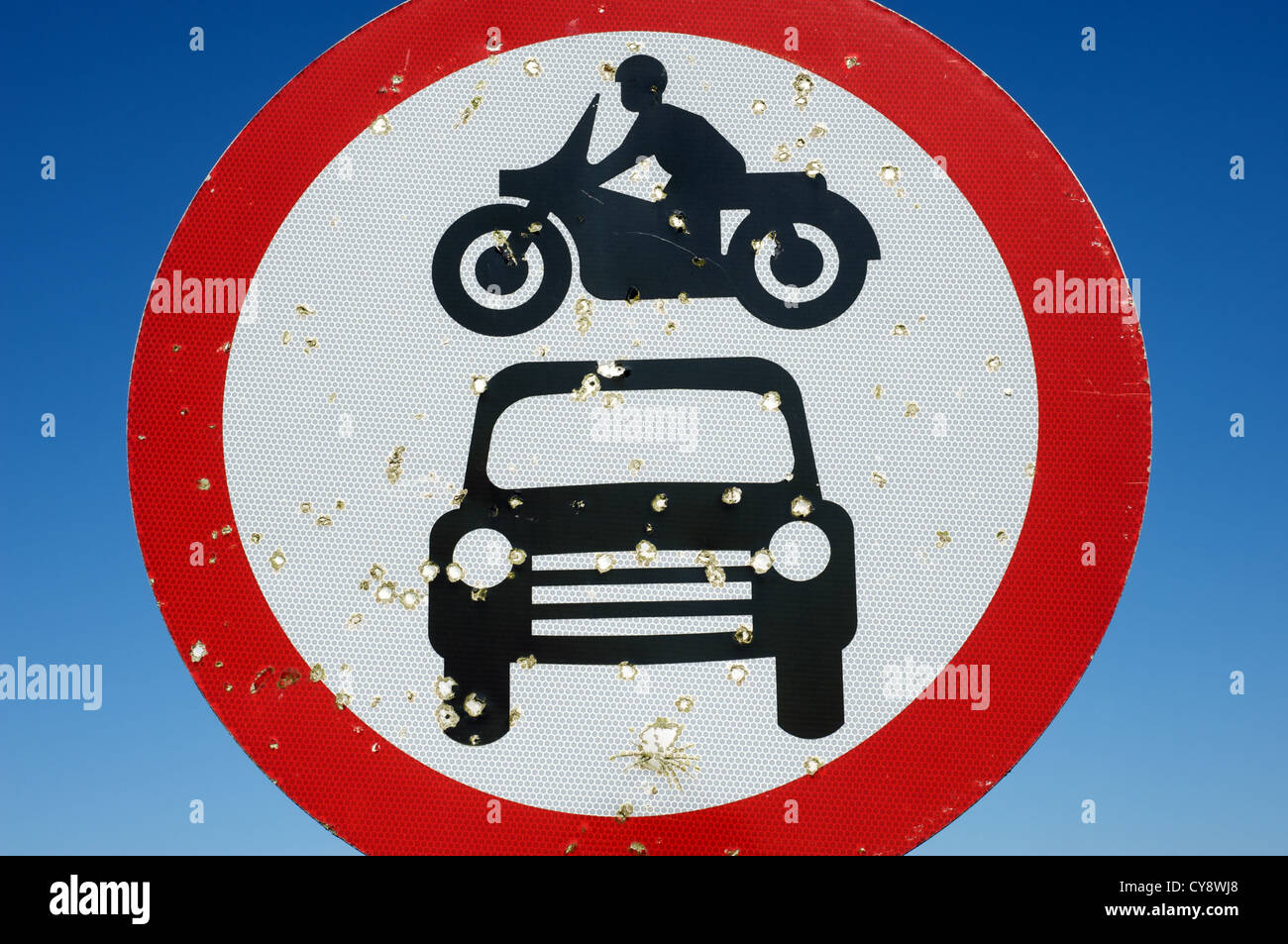 No motor vehicles sign (UK) which has been shot with air riffle pellets - Stock Image