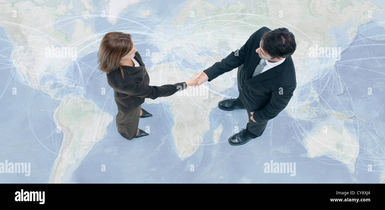 Business professionals engage in global business transactions - Stock Image