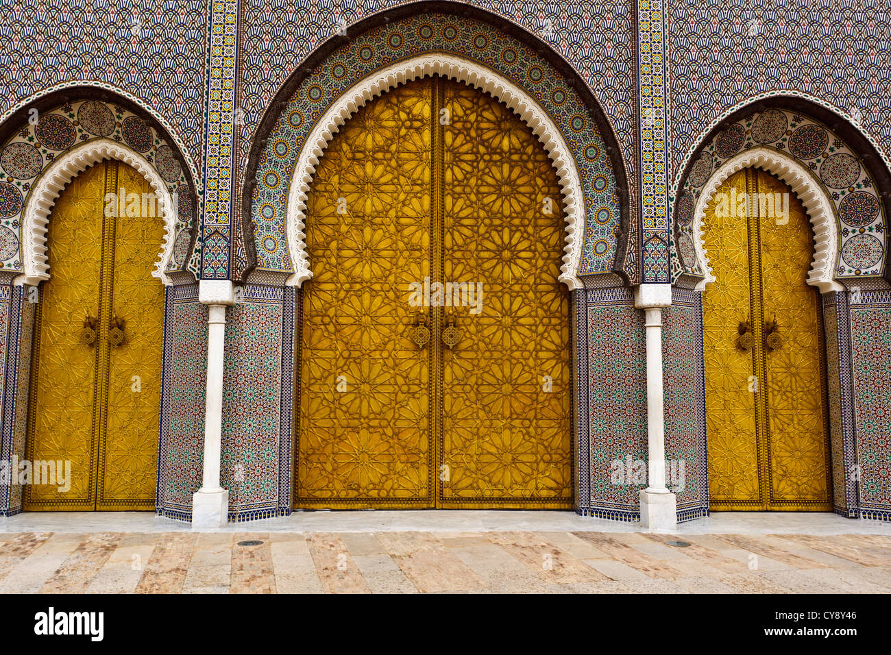 Closeup of 3 main Ornate Brass and Tile Doors to Royal Palace in Fez, Morocco - Stock Image