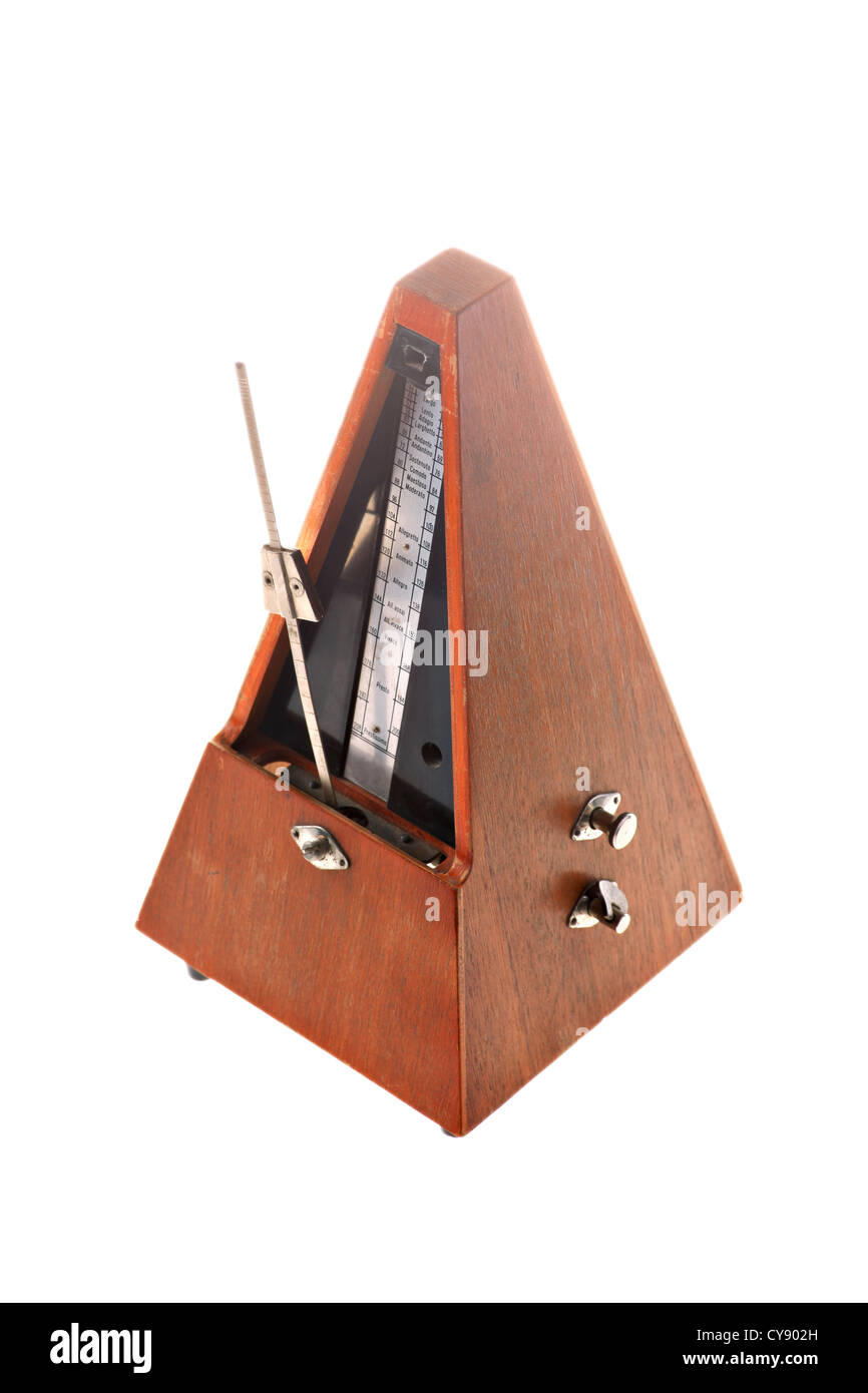 Vertical shot of a vintage metronome isolated on white Stock Photo