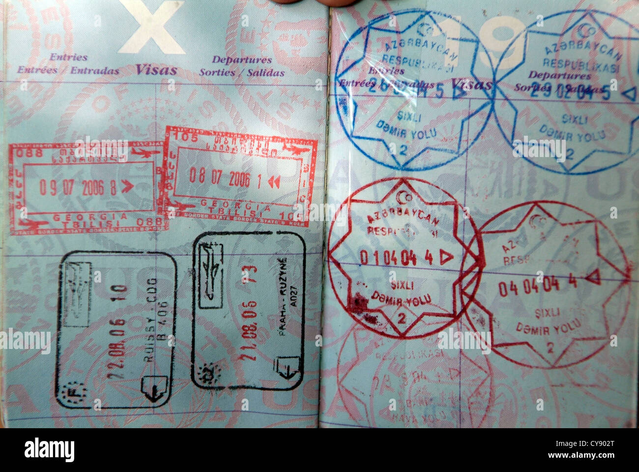 US PASSPORT open at pages showing visa stamps - Stock Image