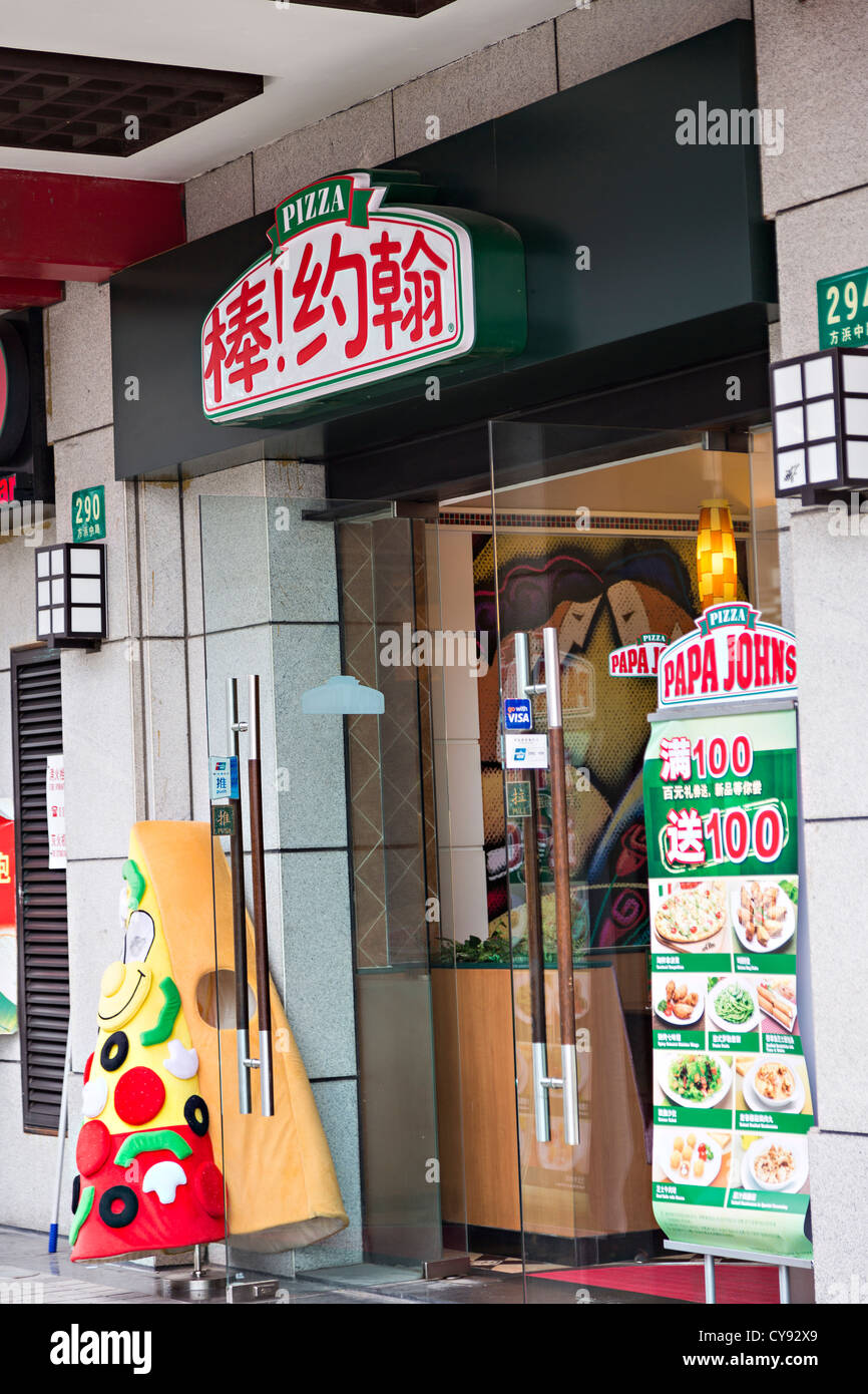 A sign for Papa Johns pizza fast food in Shanghai, China - Stock Image