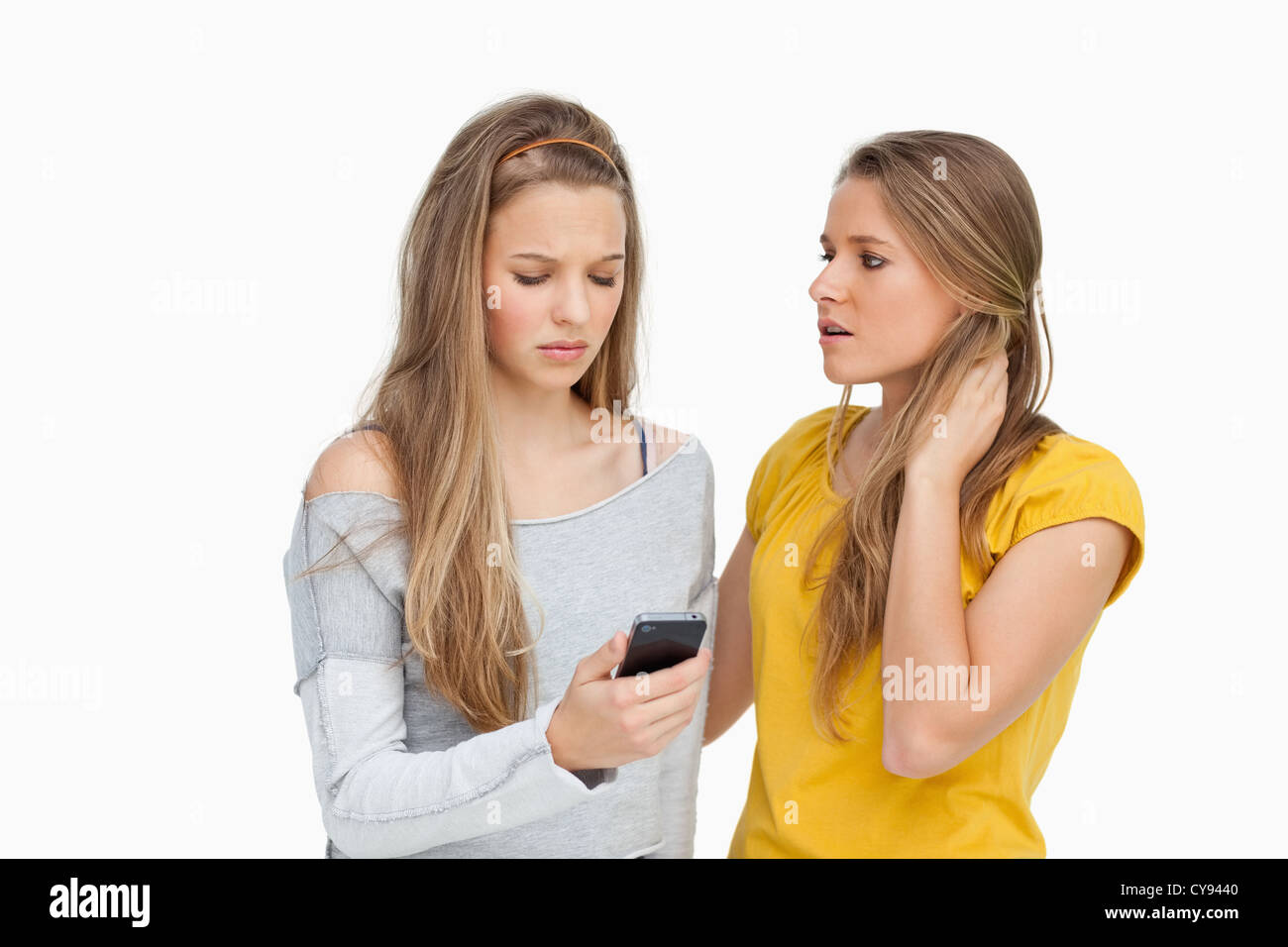 Upset young woman consoled by her friend - Stock Image