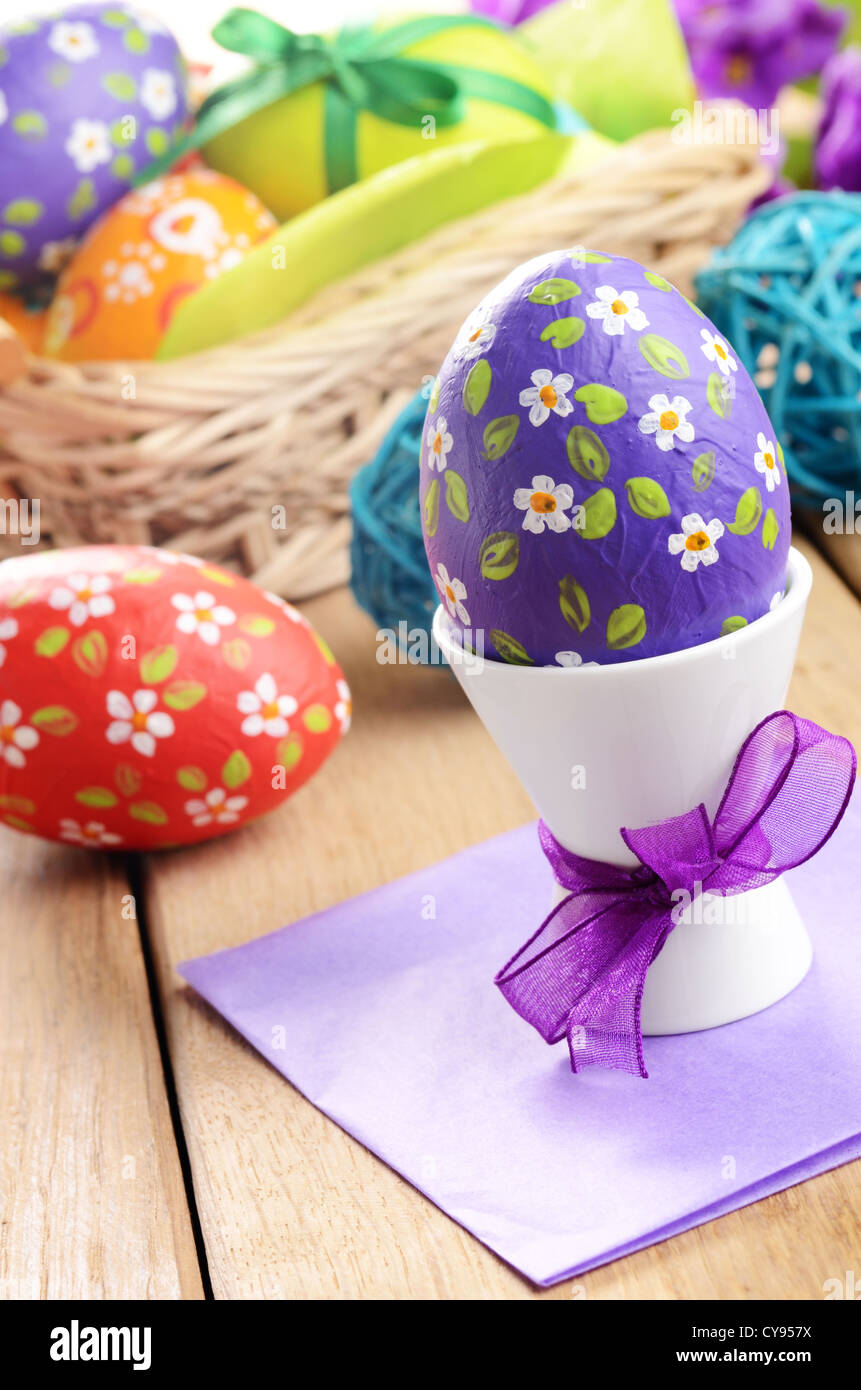 Hand crafted easter eggs with wicker basket - Stock Image