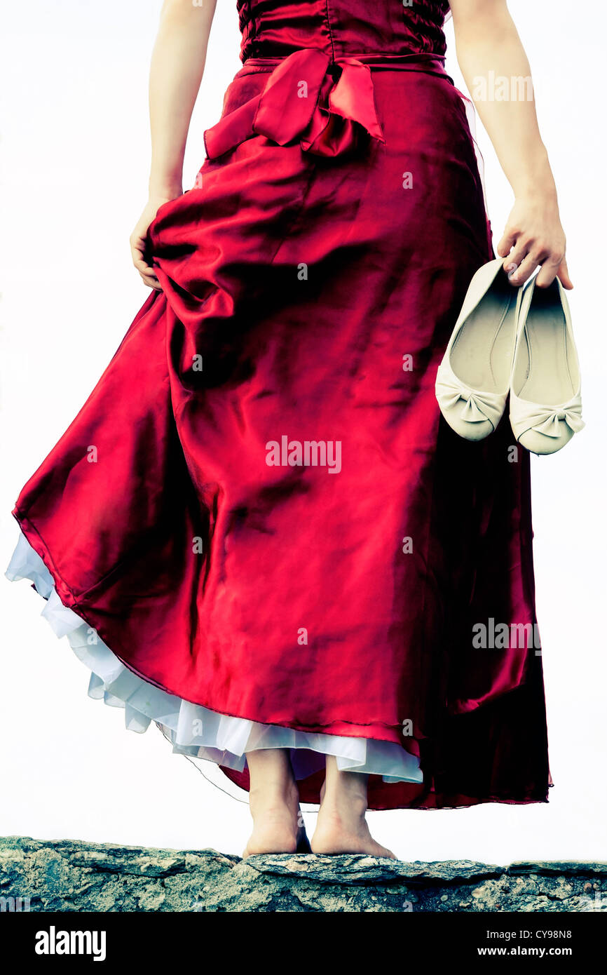 a woman on a wall - Stock Image