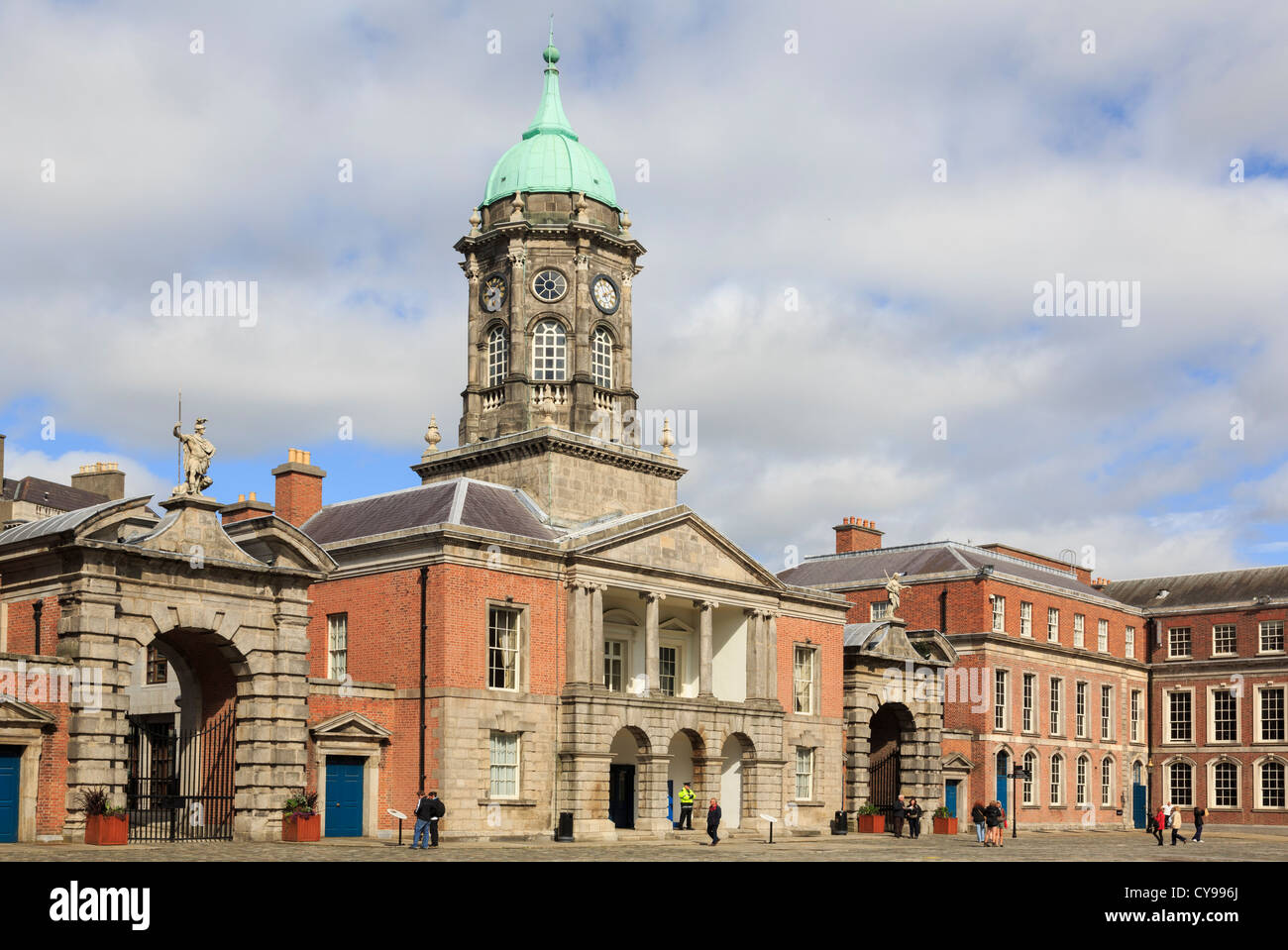 Fortitude gate beside 18th century Bedford tower in Dublin castle's Great Courtyard with tourists in Dublin, - Stock Image