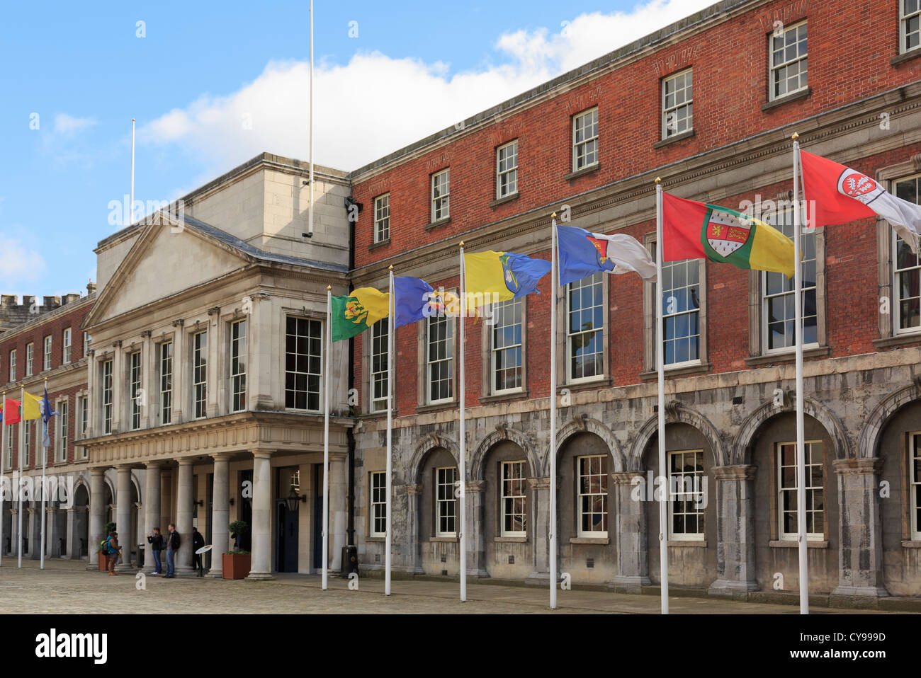 Dublin, Republic of Ireland, Eire. State apartments and international flags in Dublin castle Upper Yard courtyard - Stock Image
