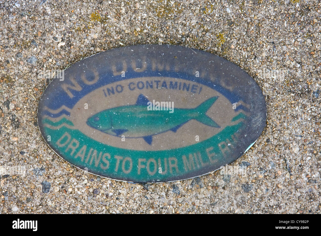 City of Alexandria No Dumping Drains to Four Mile Run oval placard on a storm drain structure. - Stock Image