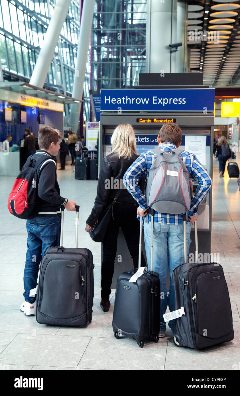 people looking at the Heathrow express service from terminal 5, Heathrow airport London UK - Stock Image