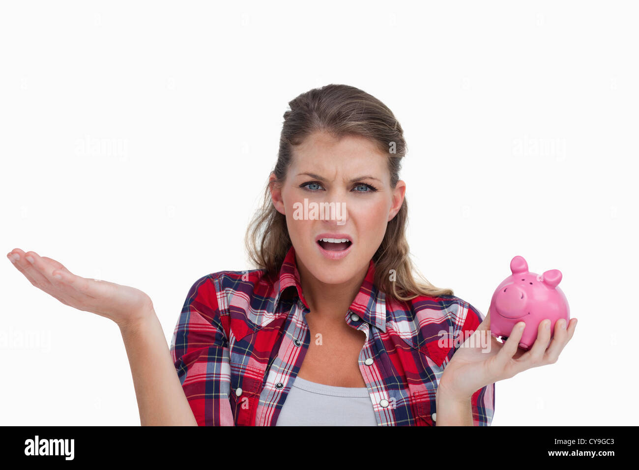 Broke woman holding a piggy bank - Stock Image