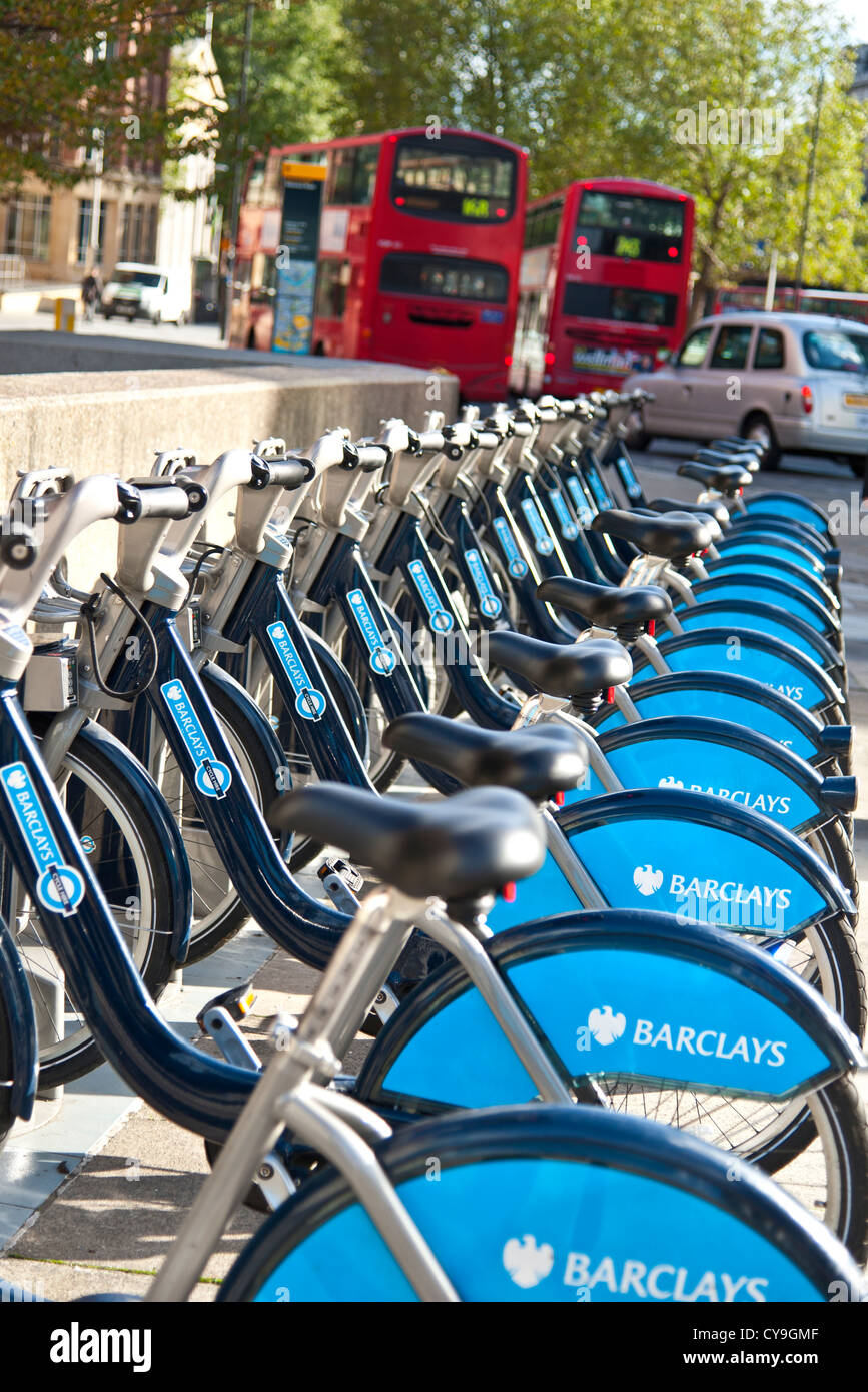 TFL London hire bikes available for rental with red London buses and taxi behind Waterloo  London UK - Stock Image