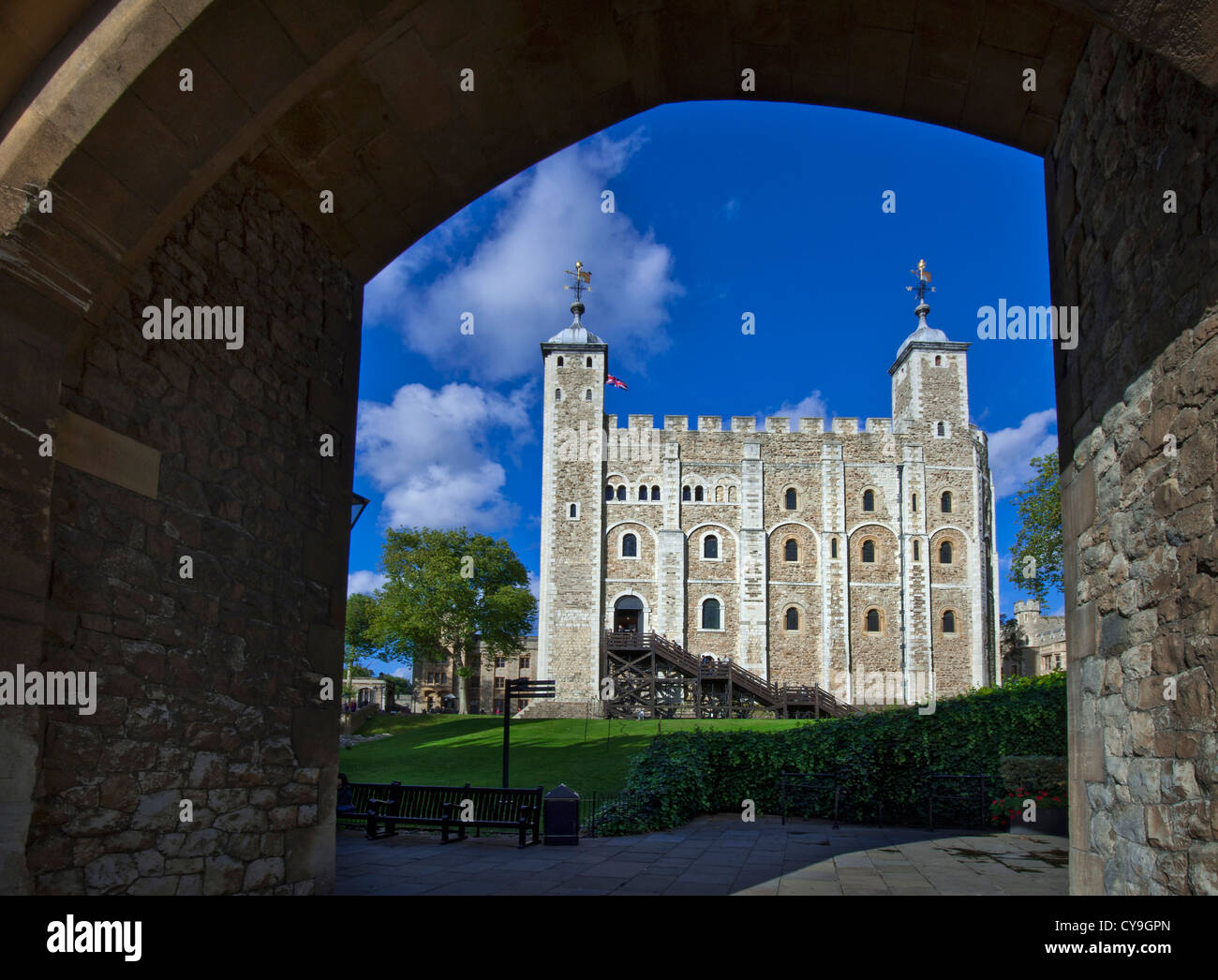 The White Tower at The Tower of London viewed through stone archway London EC3 UK - Stock Image