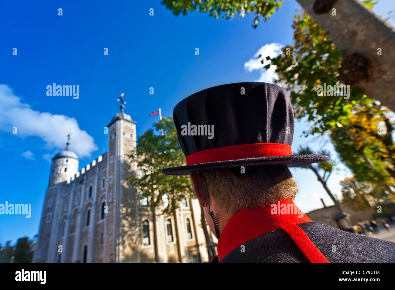 Yeoman Warder ( Beefeater) with security earpiece on duty at The Tower of London City of London UK - Stock Image