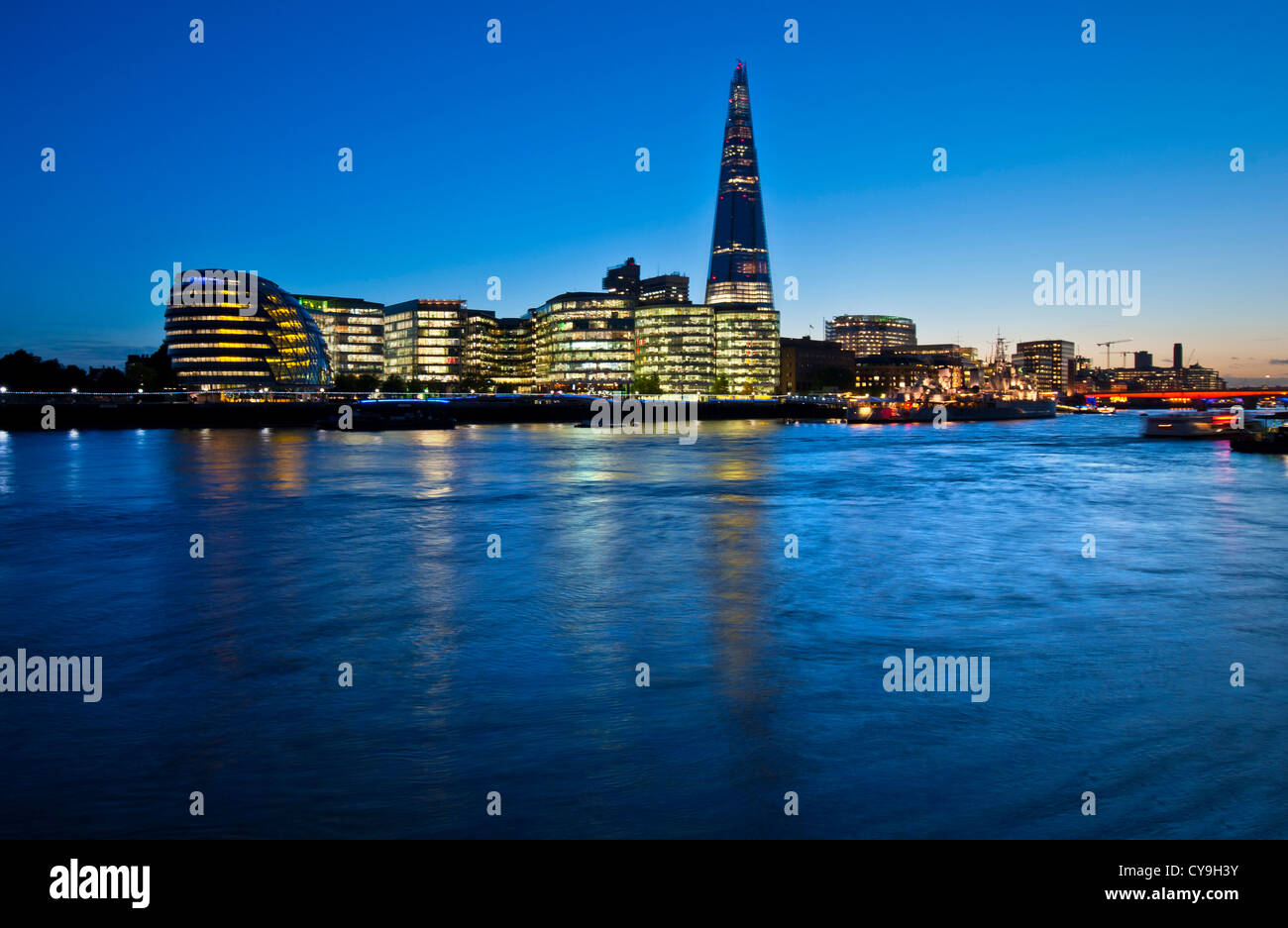 The Shard, City Hall and contemporary London city skyline, lit at dusk, River Thames, Southwark, SouthBank, London, - Stock Image