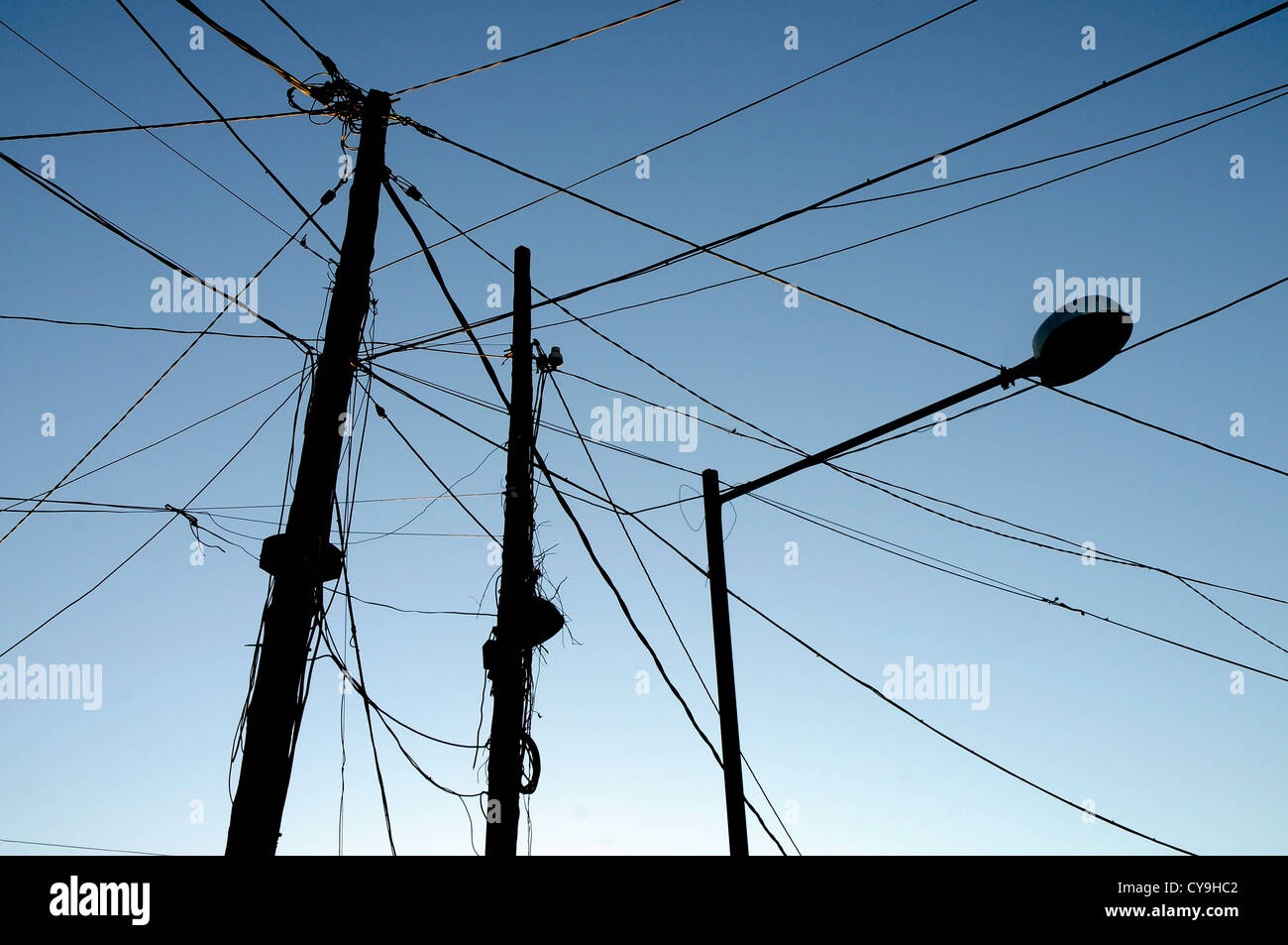 silhouette of obsolete electric cables ELECTRICITY power - Stock Image