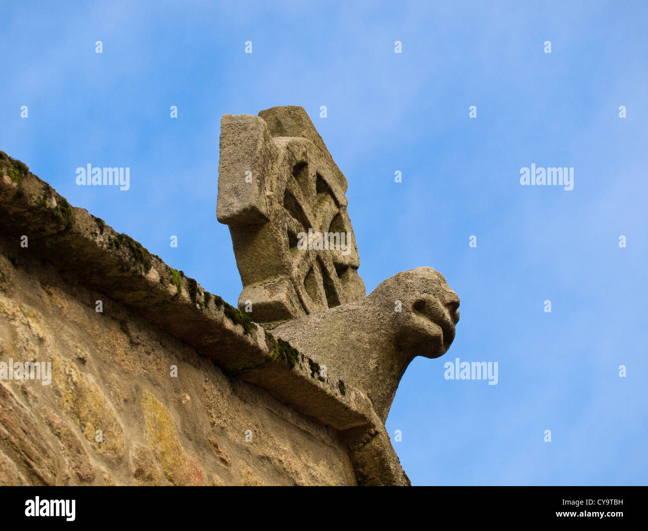 Ancient romanesque sculpture in the roof of Saint Mary of Figueiras church - Stock Image