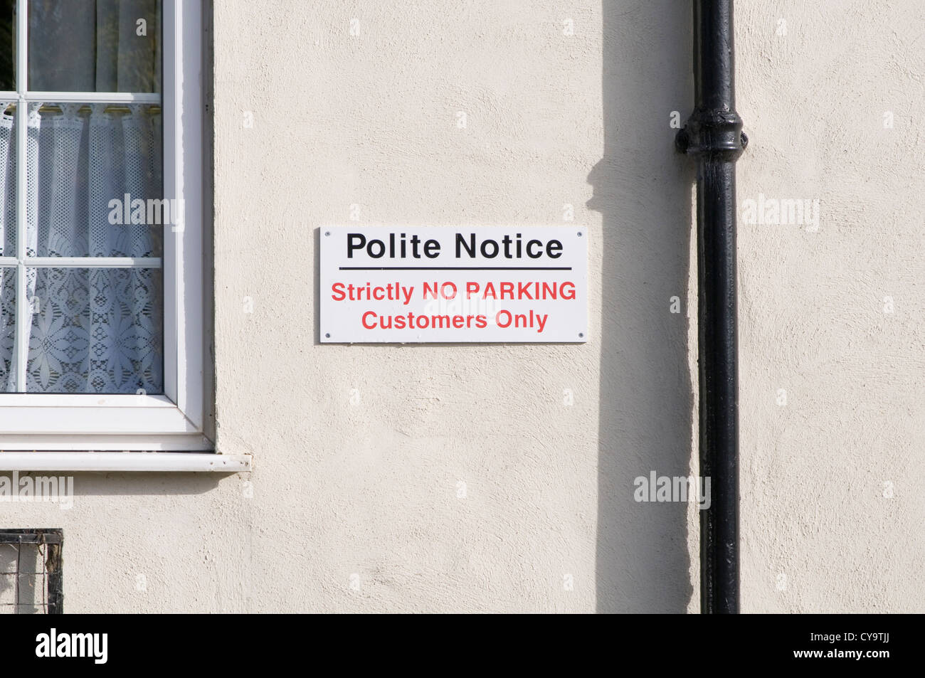 polite no parking sign signs notice private land customers only - Stock Image