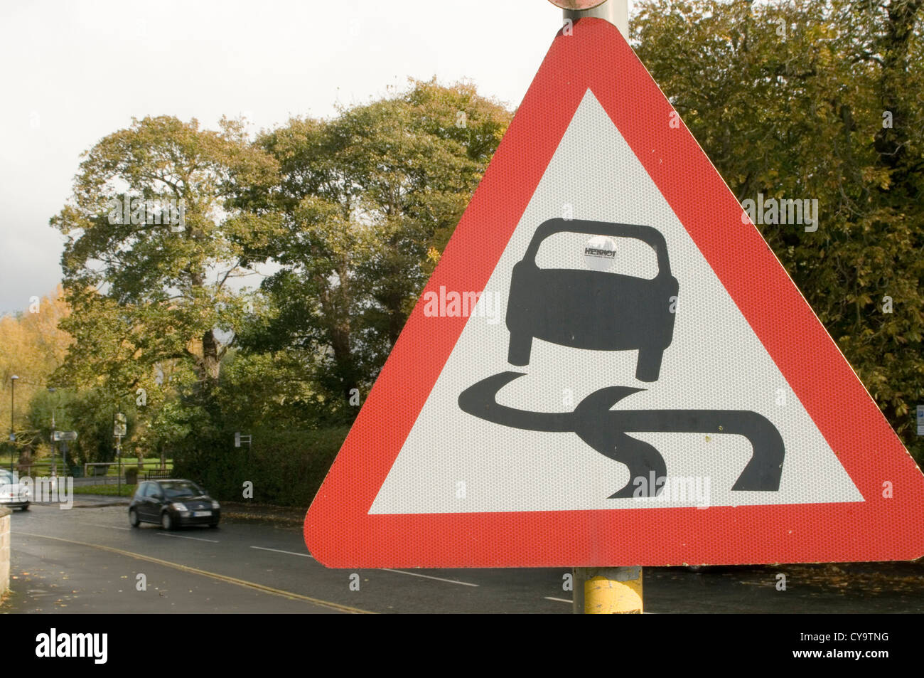 slippery roadsign road sign signs roadsigns coefficient of friction skid skidding skiddy slide drift drifting grip - Stock Image
