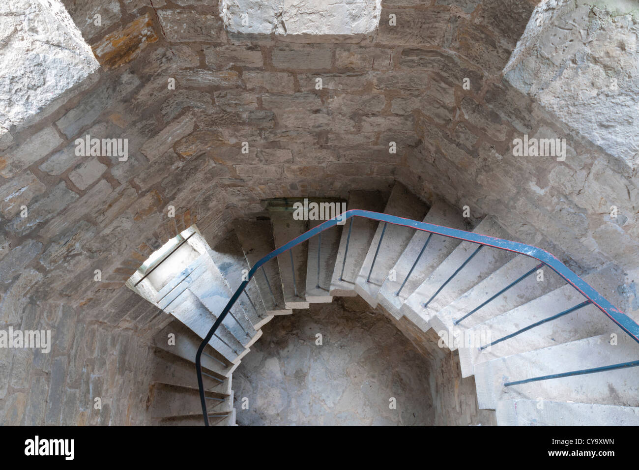Concrete Spiral Stairs With Metallic Handrails Go Down   Stock Image