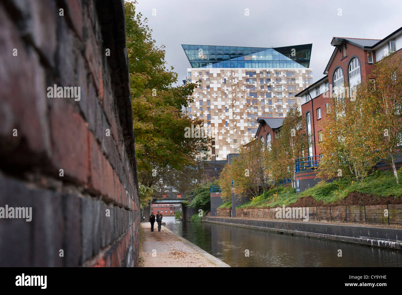 The towpath along the Birmingham and Worcester Canal, and new buildings, near the city centre, Birmingham - Stock Image