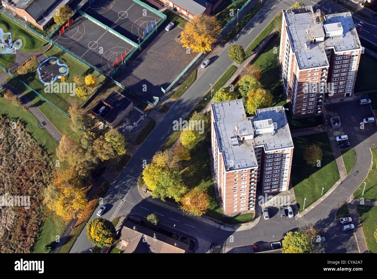 aerial view of tower blocks with autumnal colours, Liverpool area - Stock Image