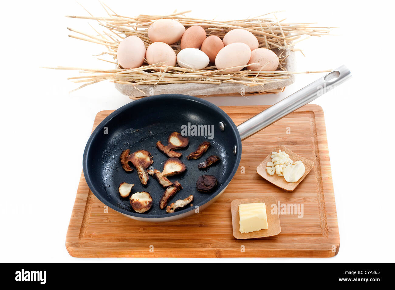 ingredients for mushroom omelette in front of white background - Stock Image