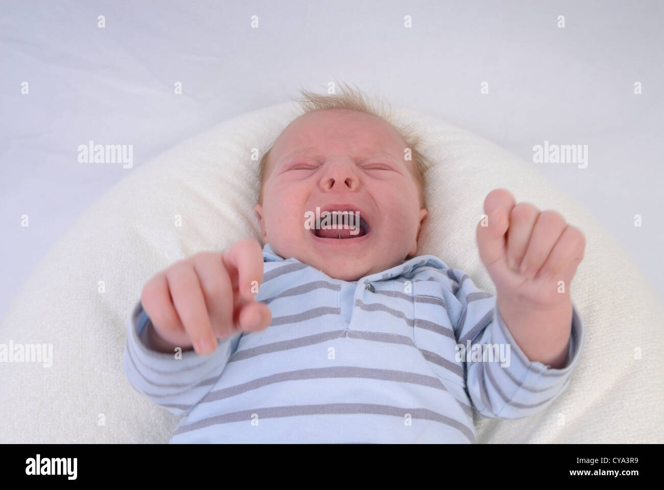 Young baby boy 6 weeks old crying, France - Stock Image