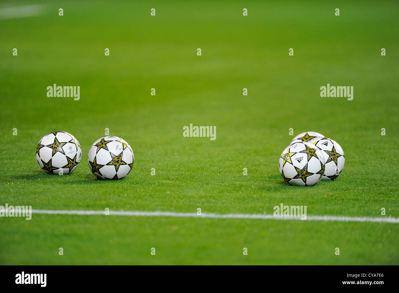 five UEFA Champions League Balls Adidas Finale 12 OMB on football pitch - Stock Image