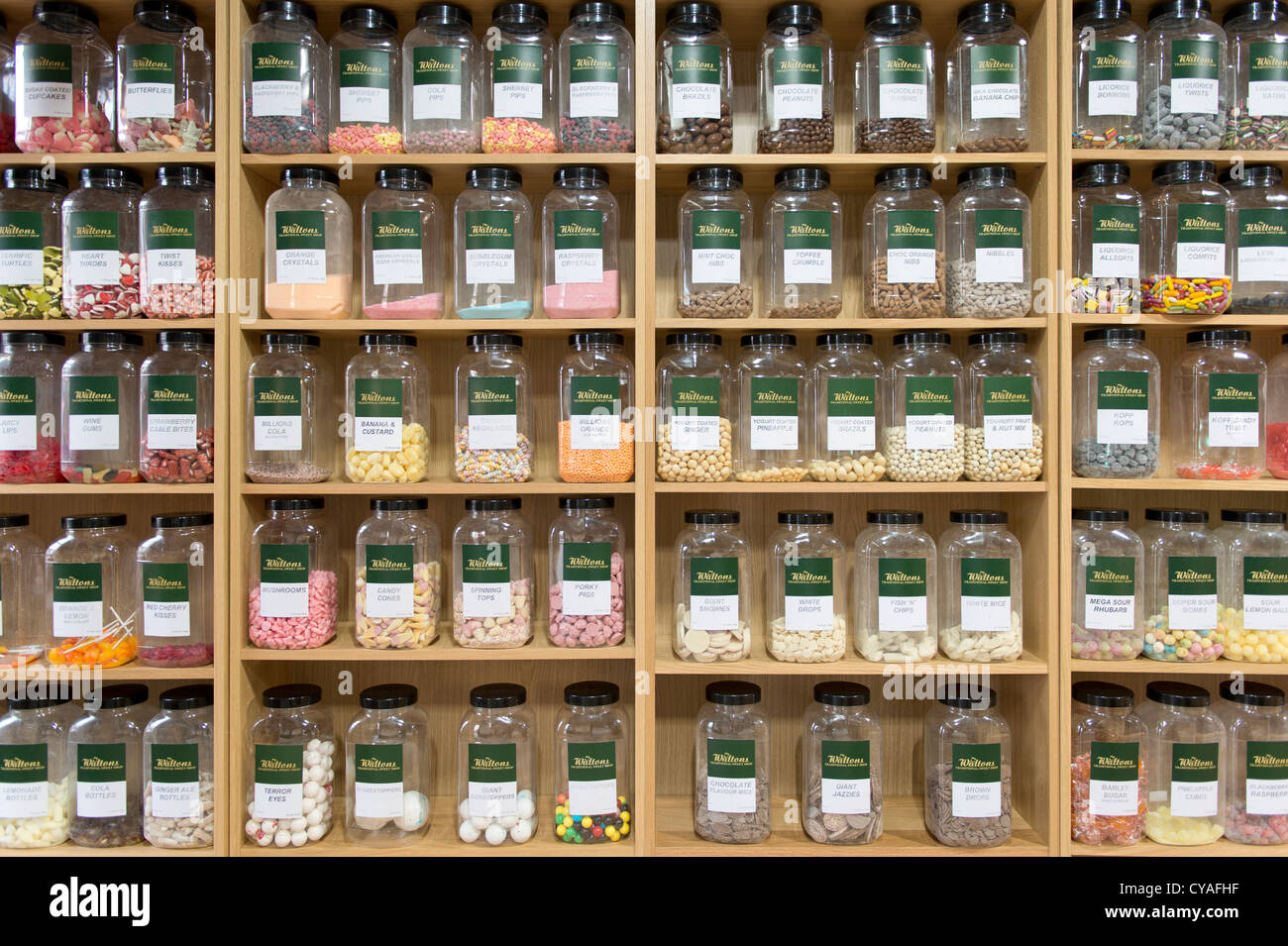 jars of confectionery sit on shelves in neat rows in traditional rh alamy com neat bookshelves neat shelves