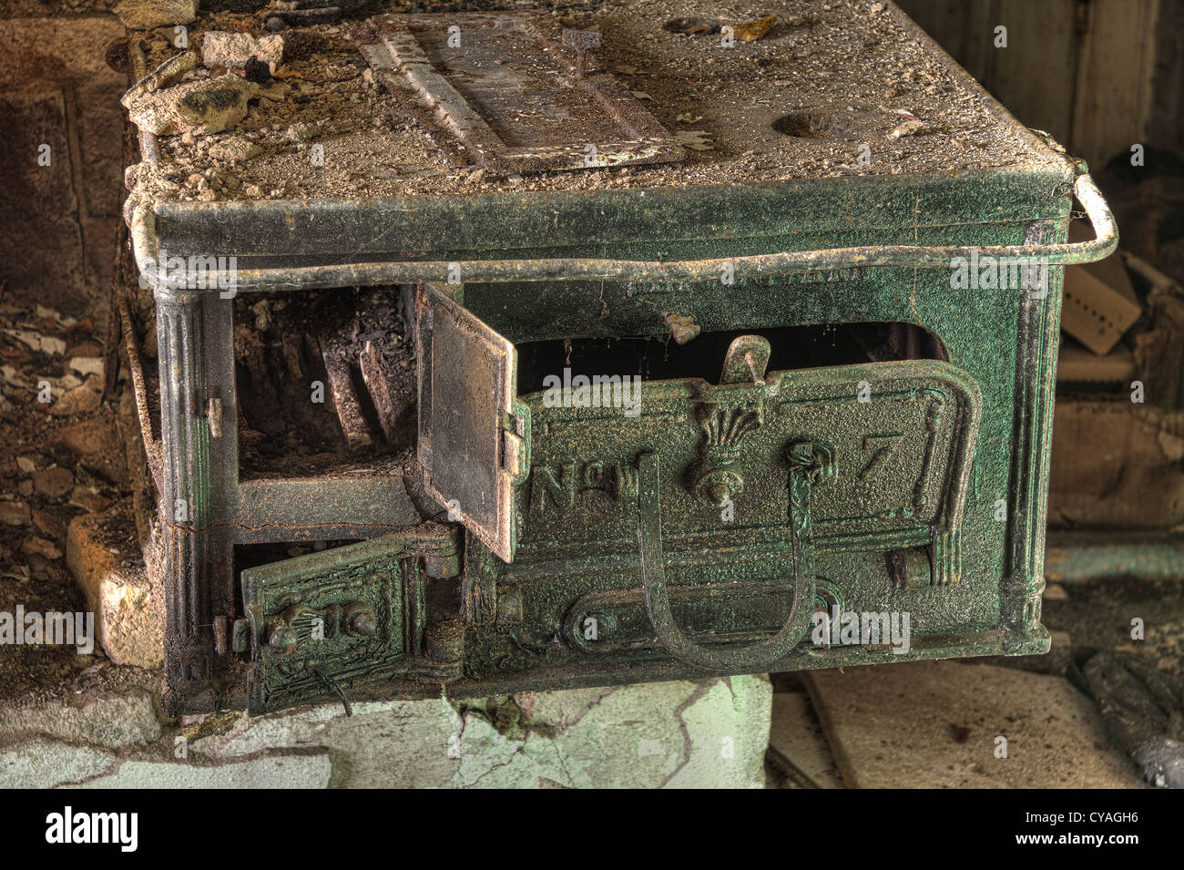 The kitchen stove in an old abandoned building - Stock Image