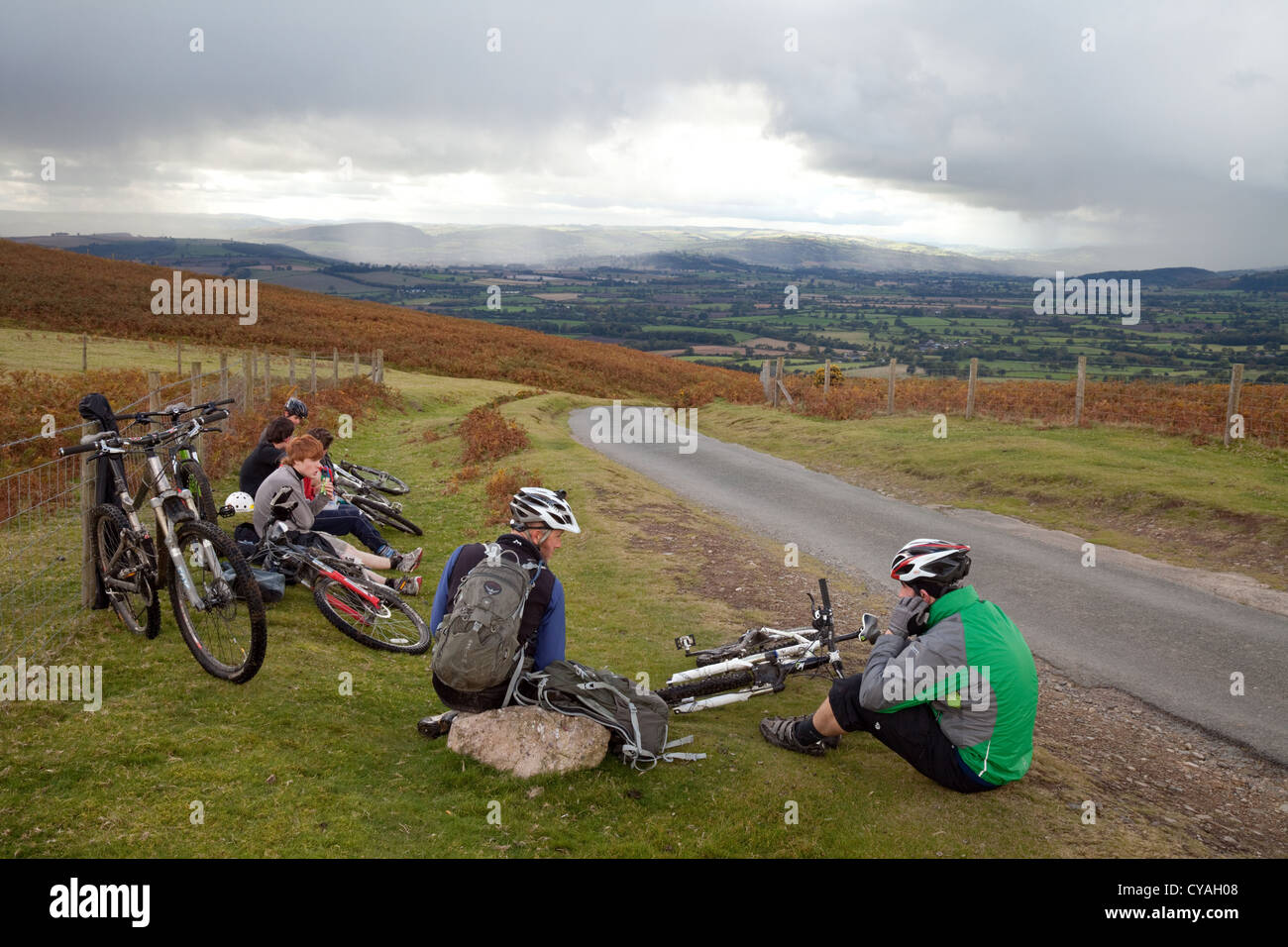 Teenage boys teens teenagers resting after cycling up the Long Mynd, Shropshire, UK - Stock Image