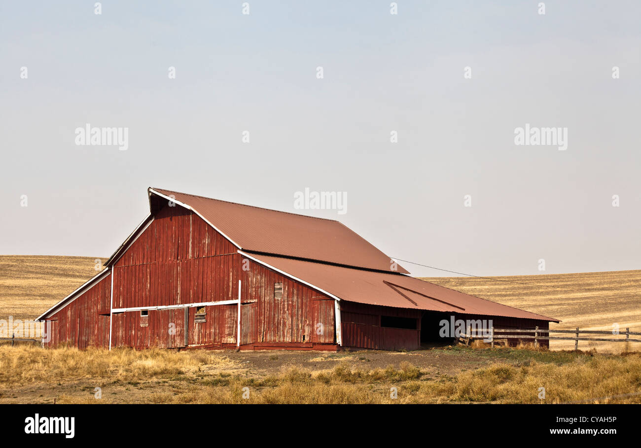 Red barn typical of the Palouse  country of Washington State USA - Stock Image
