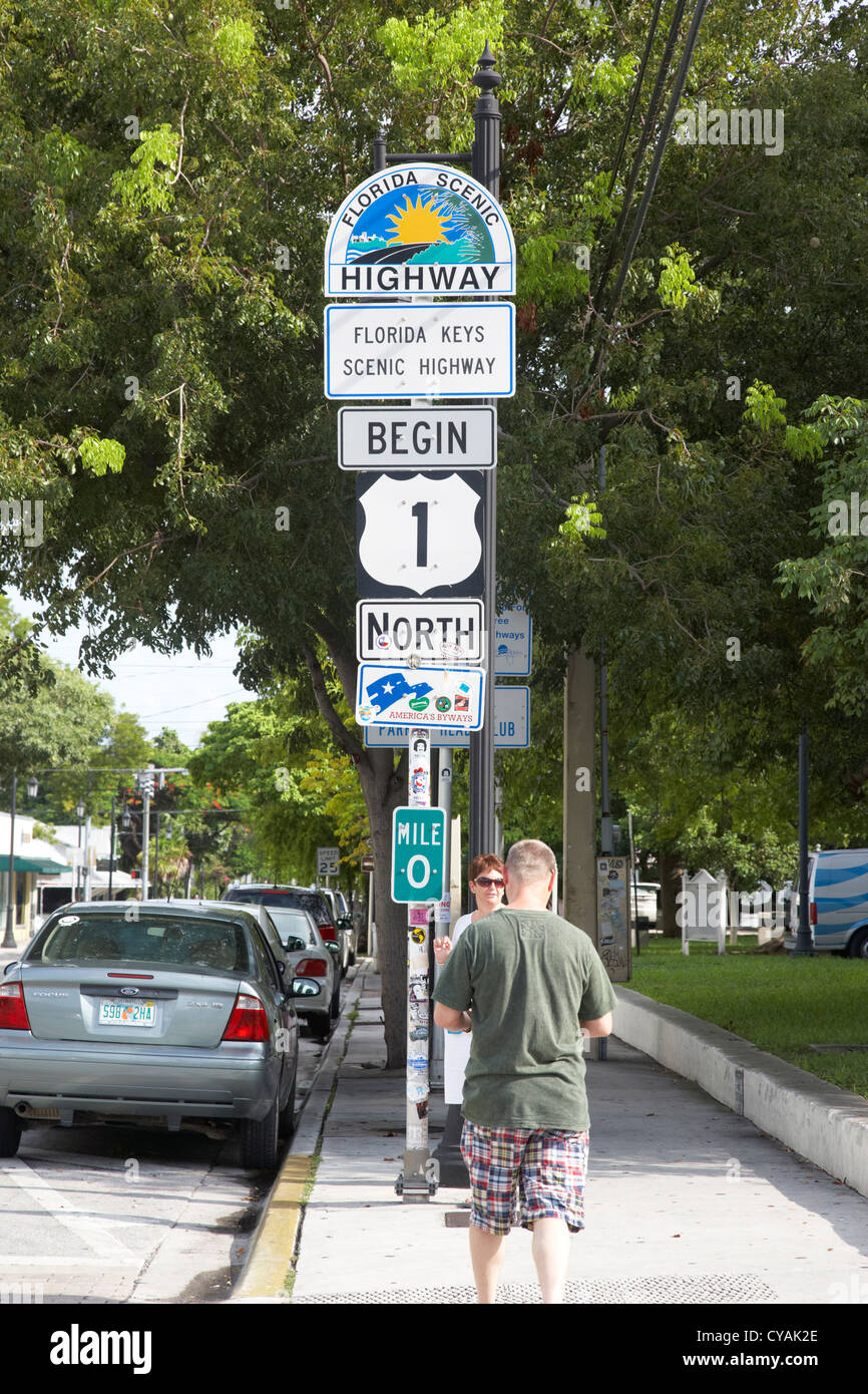 Tourists at us route 1 mile marker 0 start of the highway key west florida usa