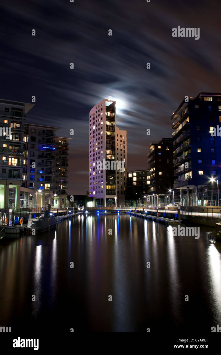 Clarence Dock in Leeds,West Yorkshire at night time.With the moon shining through tower. - Stock Image
