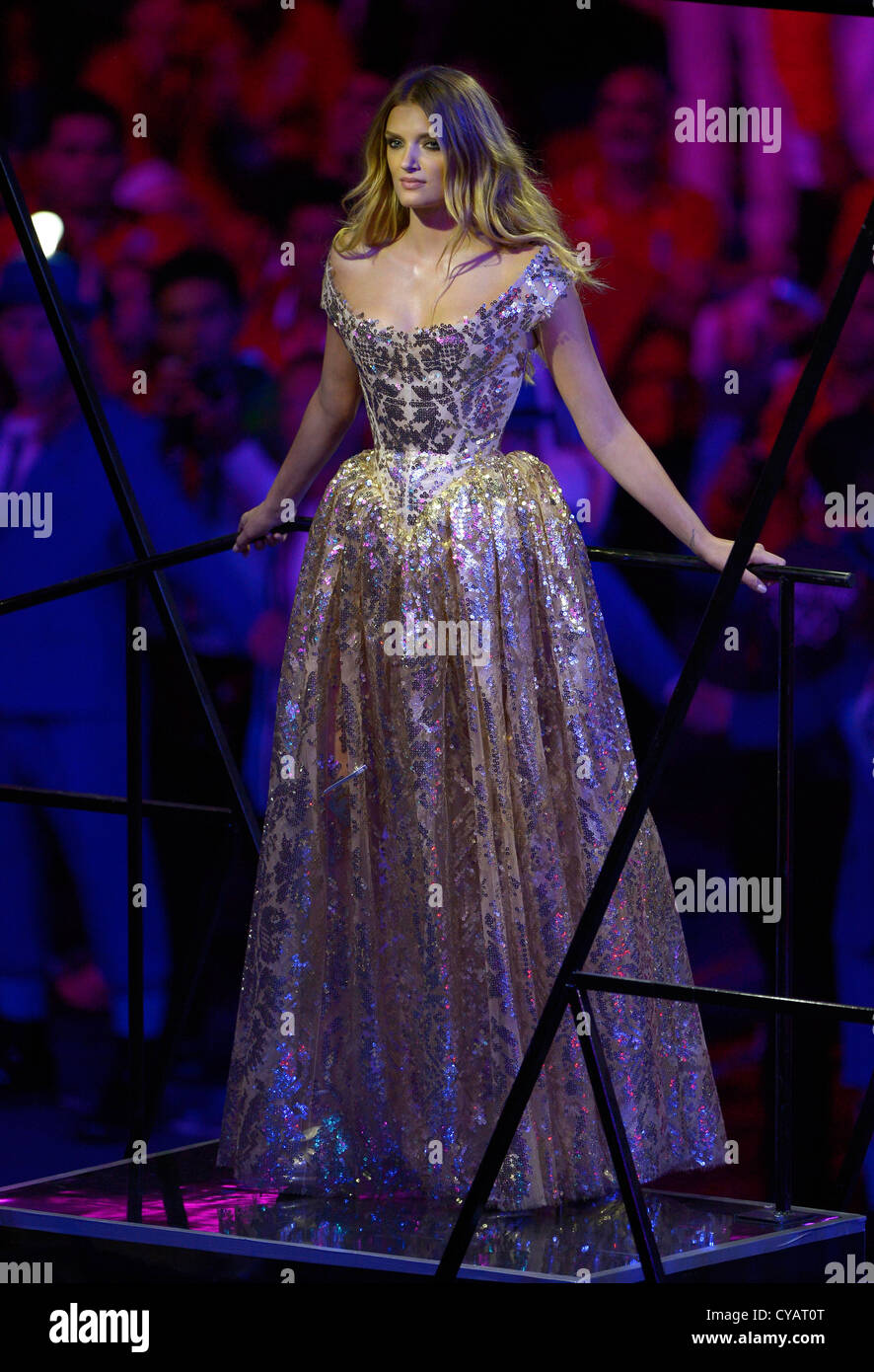 6a0f856ee57 fashionBritish Model Lily Donaldson wearing a gold ball gown by Vivienne  Westwood at the London 2012