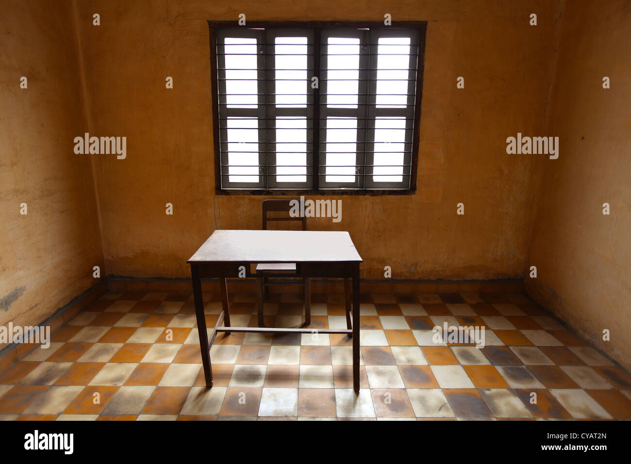Room with a table, ascetic and old with tiles, prison room - Stock Image