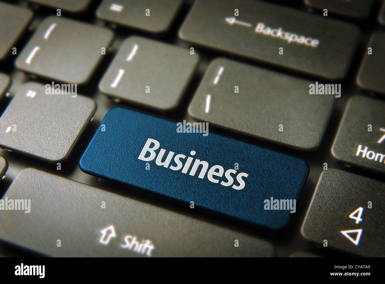 Expand your company with internet: blue key with business word on laptop keyboard. Included clipping path, so you Stock Photo
